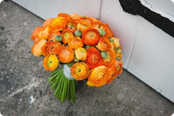 Orange wedding flowers by Chris Milner Photography