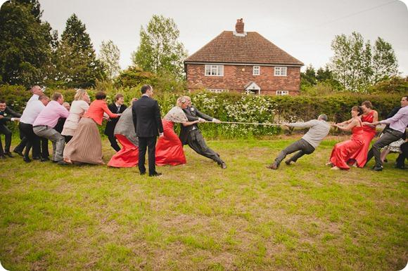 Tug of war at a wedding by Chris Milner Photography